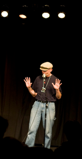 on stage at an open mic, Victoria, 2011